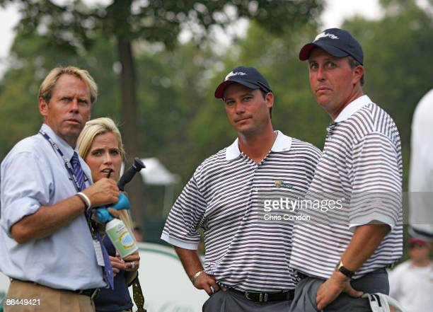 Rules official John Brendle and Amy Mickelson with Chris DiMarco and Phil Mickelson of the US team during the second round of The Presidents Cup at...