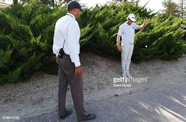 A rules official looks on as golfer Seamus Power of Ireland takes his drop out of the rough during the second round of the Utah Championship...