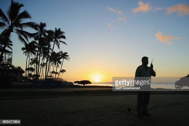 PGA rules official Slugger White talks on a radio during the proam tournament prior to the Sony Open In Hawaii at Waialae Country Club on January 10...