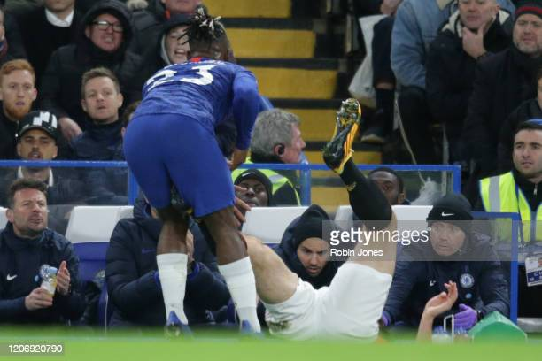 VAR rules out a red card for Harry Maguire of Manchester United after he catches Michy Batshuayi of Chelsea during the Premier League match between...