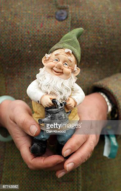 Ruling council member Jekka McVicar of the Royal Horticultural Society holds her lucky gnome on her stand Jekka's Herb Farm on May 18 2009 in London...