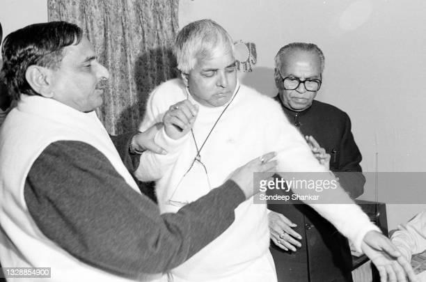 Ruling Janata Dal leaders Mulayam Singh Yadav and Lalloo Prasad share a light moment after a meeting in New delhi, India November 27, 1995.