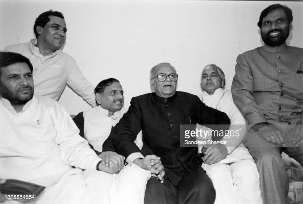 Ruling Janata Dal leaders Sharad Yadav, Mulayam Singh Yadav; Lalloo Prasad and Ramvilas Paswan share a light mo0ment after a meeting in New delhi,...