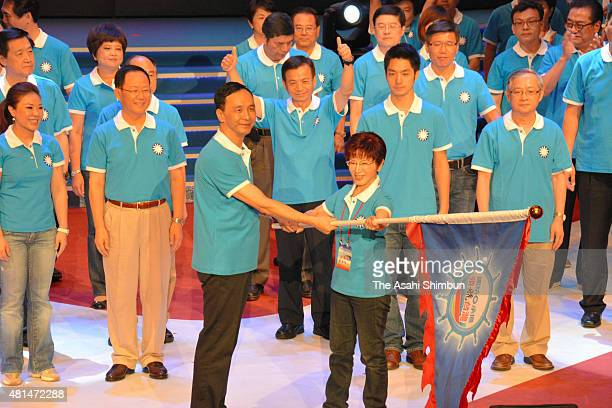 Ruling Kuomintang Party presidential election candidate Hung Hsiu-Chu receives a flag from the party chairman Eric Chu after being selected during...