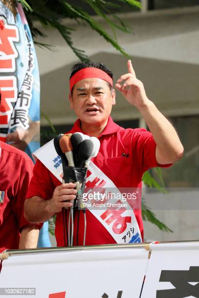 Ruling Liberal Democratic Party backed candidate Atsushi Sakima makes a street speech calling for support as the Okinawa gubernatorial election...
