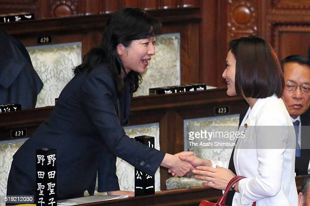 Ruling Liberal Democratic Party Lawmaker Megumi Kaneko shke hands with veteran lawmaker Seiko Noda before a lower house plenary session after her...