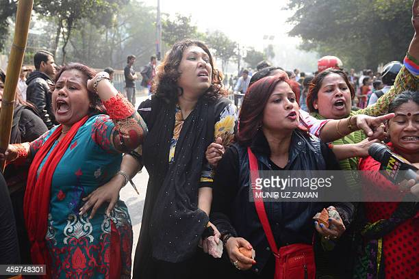 Ruling party Bangladesh Awami League supporters seen holding stones react and gesture against Bangladesh Nationalist Party lawyers outside the High...