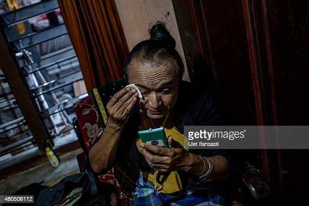 Rulli, a member of a Pesantren boarding school, Al-Fatah, for transgender people known as 'waria' cleans her face during Ramadan on July 12, 2015 in...