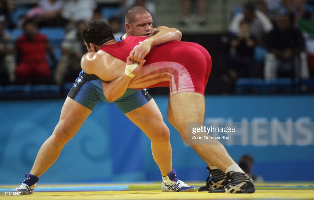 Rulon Gardner of the (blue) USA is tied up with Sajad Barzi of Iran during the men's Greco-Roman wrestling 120 kg bronze medal match round on August 25, 2004 during the Athens 2004 Summer Olympic Games at Ano Liossia Olympic Hall in Athens, Greece.