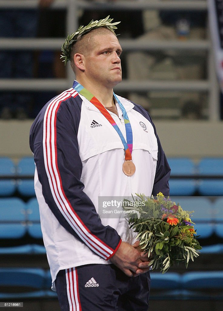 Rulon Gardner of the USA receives the bronze medal during ceremonies for the men's Greco-Roman wrestling 120 kg event on August 25, 2004 during the Athens 2004 Summer Olympic Games at Ano Liossia Olympic Hall in Athens, Greece.