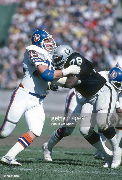 Rulon Jones of the Denver Broncos in action against Art Shell of the Oakland Raiders during an NFL Football game October 4 1981 at the OaklandAlameda...