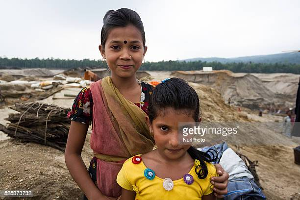 Ruma posed for the camera with her friend Kohinoor inside stone extraction site on April 4 2015 in Jaflong Sylhet Bangladesh Stone workers live a...