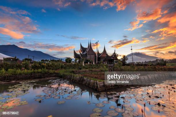rumah gadang at sunset in west sumatra indonesia picture