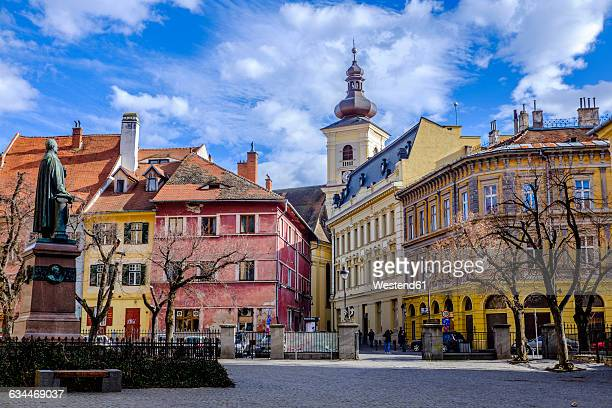 rumania, sibiu, bishop teutsch monument on square albert huet - sibiu stock photos and pictures