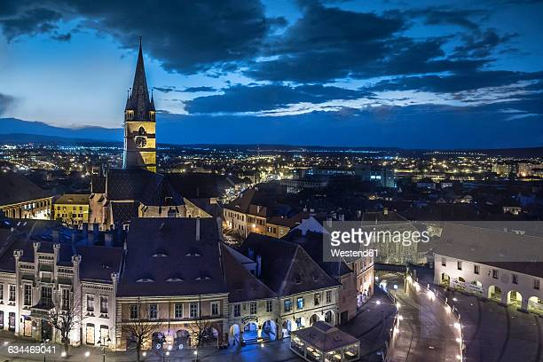 rumania, sibiu, old town, evangelical church in the evening - sibiu stock photos and pictures