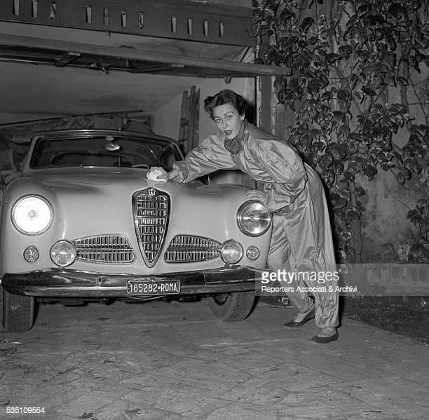 Rumanian actress Nadia Gray posIng with her Alfa Romeo italy 1953