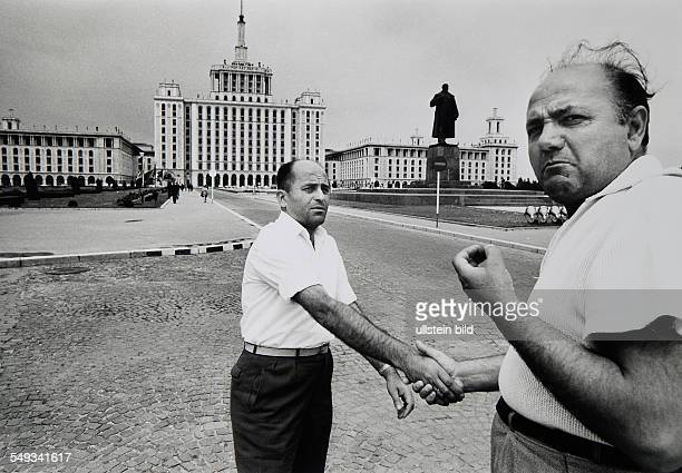 Rumanian Bucharest two men shaking hands in front of Lenin monument