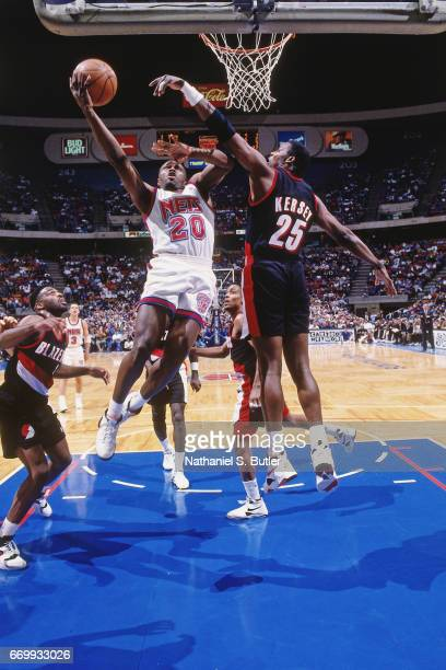 Rumeal Robinson of the New Jersey Nets shoots against the Portland Trail Blazers during a game played circa 1993 at the Brendan Byrne Arena in East...