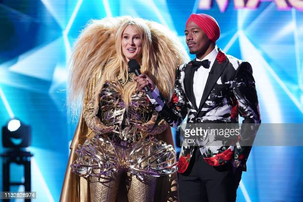 Rumer Willis and host Nick Cannon in the Semi Finals Double Unmasking episode of THE MASKED SINGER airing Wednesday Feb 20 on FOX