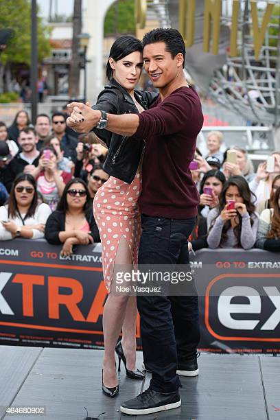 """Rumer Willis and Mario Lopez pose together at """"Extra"""" at Universal Studios Hollywood on February 27, 2015 in Universal City, California."""