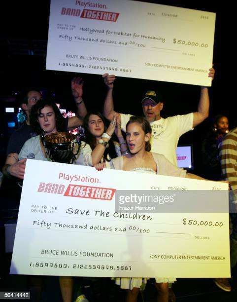 Rumer Willis Scout Willis Tallulah Willis and Bruce Willis are seen presenting the charity checks onstage during Playstation BANDtogether a benefit...