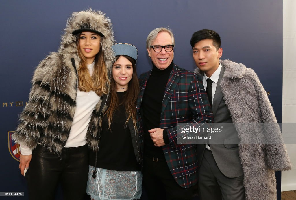 Rumi Neely, Elizabeth Hilfiger, Tommy Hilfiger and Bryan Boy pose backstage at the Tommy Hilfiger Fall 2013 Women's Collection fashion show during Mercedes-Benz Fashion Week at the Park Avenue Armory on February 10, 2013 in New York City.