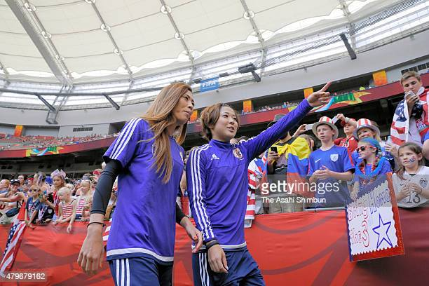 Rumi Utsugi and Asano Nagasato of Japan enter the pitch prior to the FIFA Women's World Cup 2015 Final between USA and Japan at BC Place Stadium on...