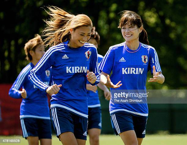 Rumi Utsugi and Nahomi Kawasumi of Japan warm up during a training session ahead of the FIFA Women's World Cup Round of 16 match against the...