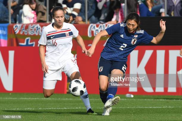 Rumi Utsugi of Japan and Guro Reiten of Norway compete for the ball during the international friendly match between Japan and Norway at Torigin Bird...