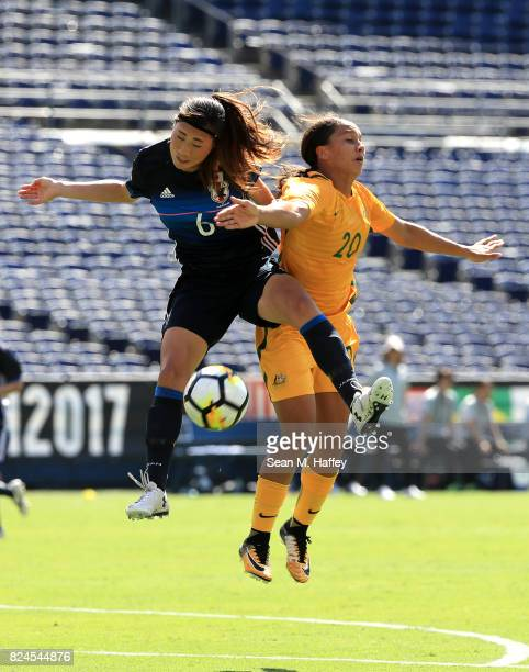 Rumi Utsugi of Japan battles Sam Kerr of Australia for a header during the second half of a match in the 2017 Tournament of Nations at Qualcomm...