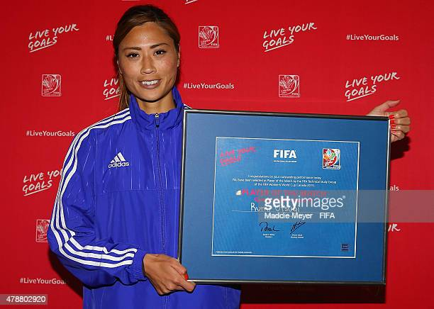 Rumi Utsugi of Japan celebrates winning Player of the Match following the FIFA Women's World Cup Canada 2015 quarter final match between Japan and...