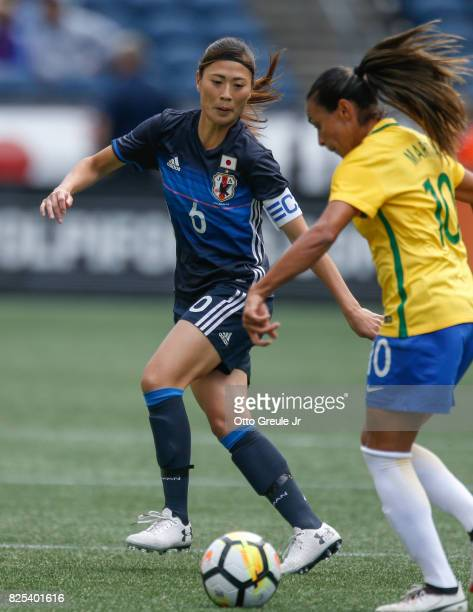 Rumi Utsugi of Japan defends against Marta of Brazil during the 2017 Tournament of Nations at CenturyLink Field on July 27 2017 in Seattle Washington