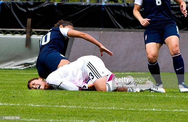 Rumi Utsugi of Japan is injured during the Swedish Invitational Women's Volvo Cup match between Japan and USA on June 18 2012 in Halmstad Sweden