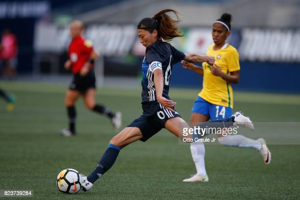 Rumi Utsugi of Japan passes against Chu of Brazil during the 2017 Tournament of Nations at CenturyLink Field on July 27 2017 in Seattle Washington