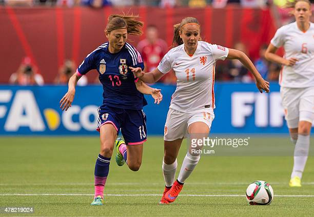 Rumi Utsugi of Japan tries to chase down Lieke Martens of the Netherlands during the FIFA Women's World Cup Canada 2015 Round of 16 match between the...
