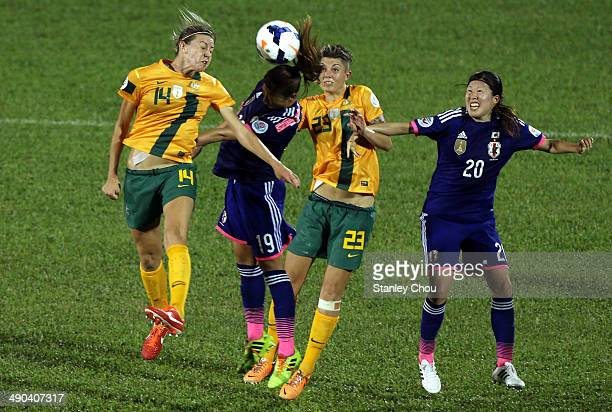 Rumi Utsugi#19 of Japan battles with Alanna Kennedy#14 and Michelle Heyman of Australia during the AFC Women's Asian Cup Group A match between...