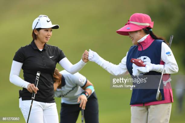 Rumi Yoshiba of Japan celebrates after making her birdie putt on the 18th hole during the first round of the Miyagi TV Cup Dunlop Ladies Open 2017 at...
