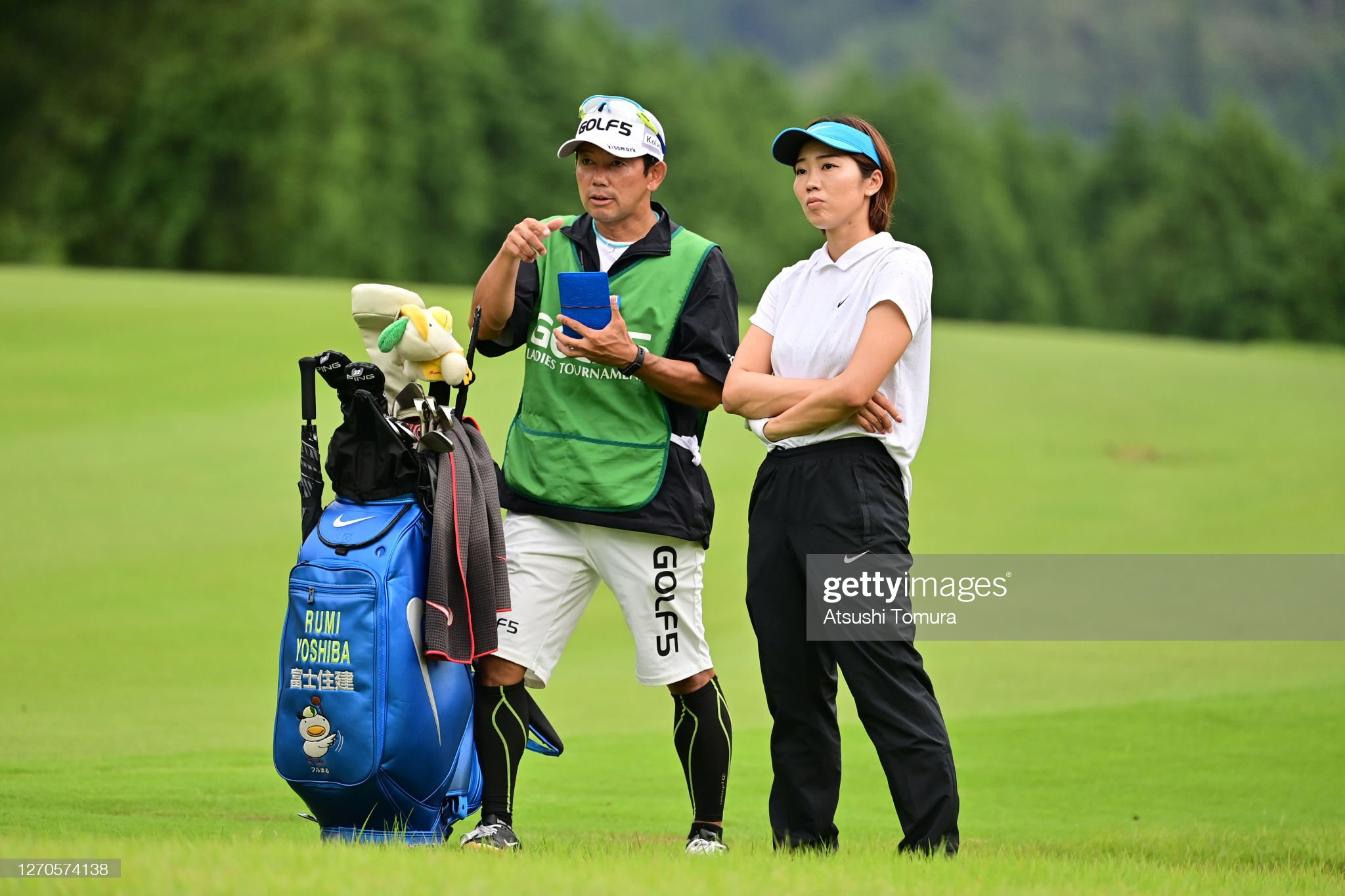 https://media.gettyimages.com/photos/rumi-yoshiba-of-japan-discusses-with-her-caddie-before-her-second-on-picture-id1270574138?s=2048x2048
