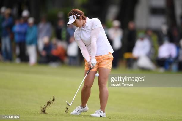 Rumi Yoshiba of Japan hits her third shot on the 18th hole during the final round of the KKT Cup Vantelin Ladies Open at the Kumamoto Kuko Country...