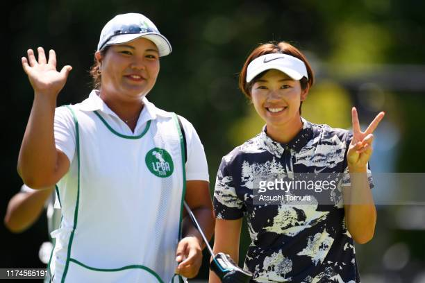 Rumi Yoshiba of Japan poses with her caddie after holing out on the 18th green during the third round of the 52nd LPGA Championship Konica Minolta...
