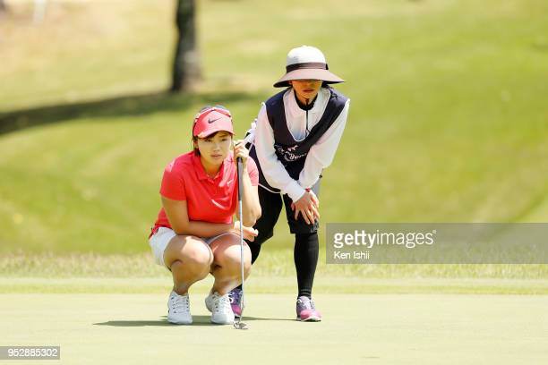 Rumi Yoshiba of Japan prepares to putt on the 5th hole during the final round of the CyberAgent Ladies Golf Tournament at Grand fields Country Club...