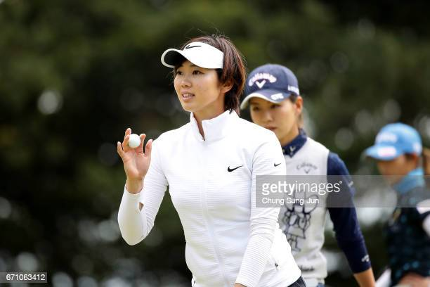 Rumi Yoshiba of Japan reacts after a putt on the 3rd green during the first round of Fujisankei Ladies Classic at the Kawana Hotel Golf Course Fuji...
