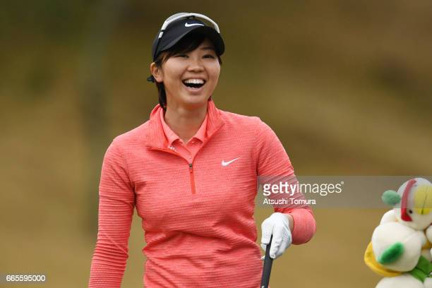 Rumi Yoshiba of Japan smiles after chipping in for eagle shot on the 16th hole during the first round of the Studio Alice Open at the Hanayashiki...