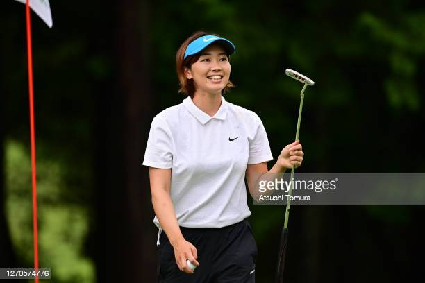 Rumi Yoshiba of Japan smiles after holing out with the birdie on the 18th green during the first round of the GOLF5 Ladies Tournament at the GOLF5...