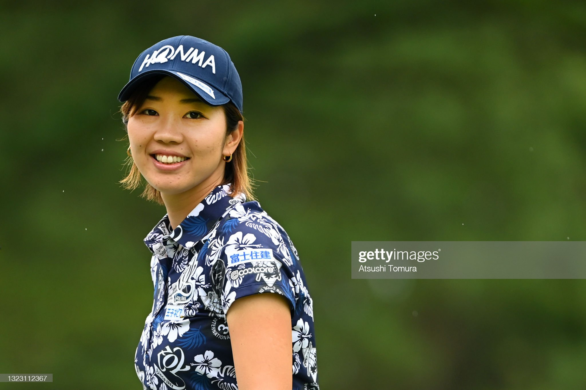 https://media.gettyimages.com/photos/rumi-yoshiba-of-japan-smiles-on-the-2nd-hole-during-the-third-round-picture-id1323112367?s=2048x2048