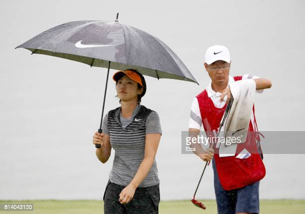 Rumi Yoshiba of Japan walks on the 18th green during the US Women's Open round one on July 13 2017 at Trump National Golf Course in Bedminster New...
