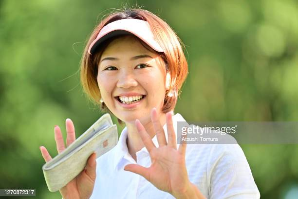 Rumi Yoshiba of Japan waves on the 1st tee during the final round of the GOLF5 Ladies Tournament at the GOLF5 Country Mizunami Course on September 6,...