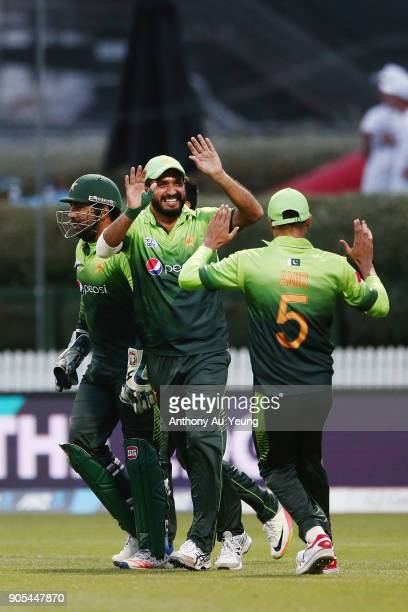Rumman Raees of Pakistan celebrates with teammates after taking a catch to dismiss Kane Williamson of New Zealand during game four of the One Day...
