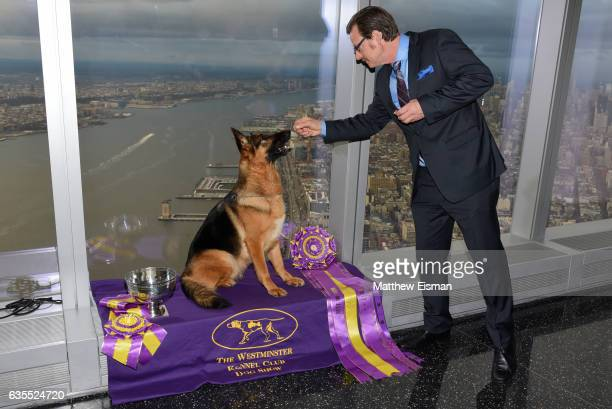 Rumor the German Shepard winner of 'Best in Show' at the Westminster Kennel Club 141st Annual Dog Show and handler Kent Boyles pose for photos at One...