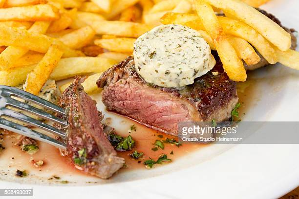 Rump steak, medium, with French fries and herb butter
